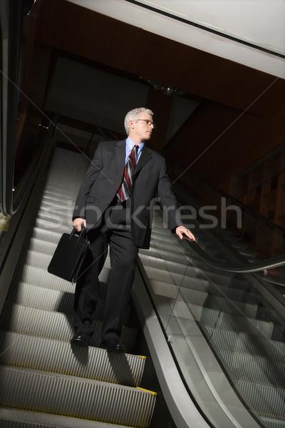 Imprenditore scala mobile adulto uomo suit Foto d'archivio © iofoto