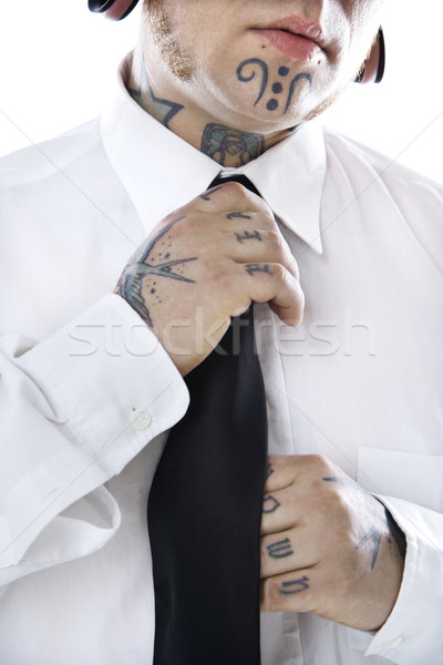 Adult male adjusting necktie. Stock photo © iofoto