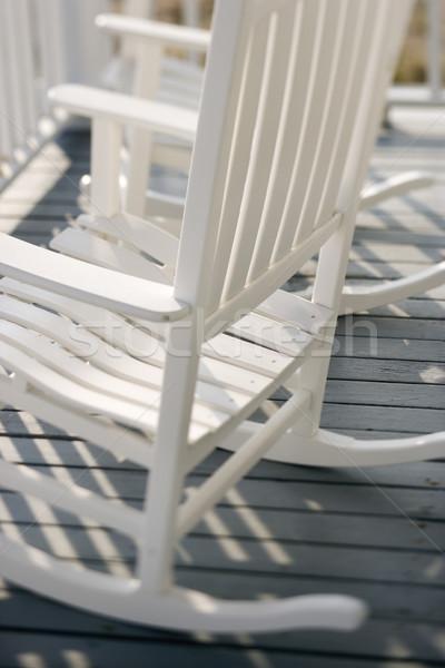 Rocking chairs on porch. Stock photo © iofoto