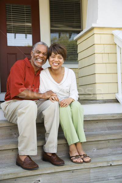 Couple Sitting on Outdoor Steps of Home Smiling Stock photo © iofoto