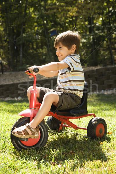 Erkek binicilik üç tekerlekli bisiklet yandan görünüş koyu esmer kırmızı Stok fotoğraf © iofoto