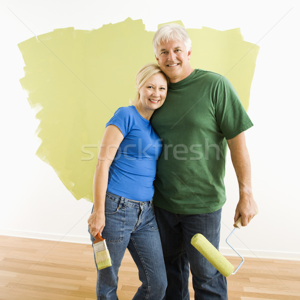 Man and woman with half-painted wall. Stock photo © iofoto