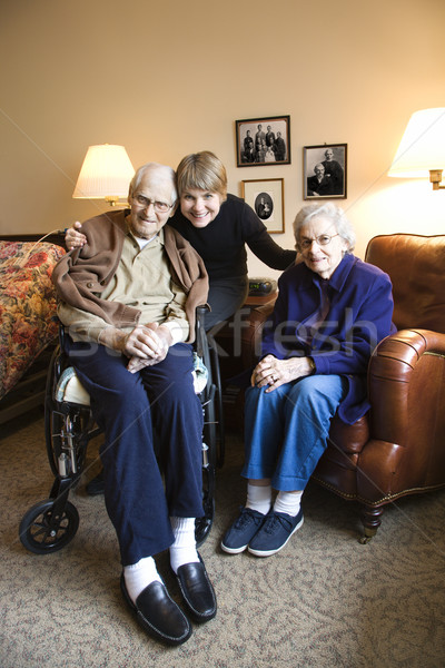 Daughter with elderly parents. Stock photo © iofoto