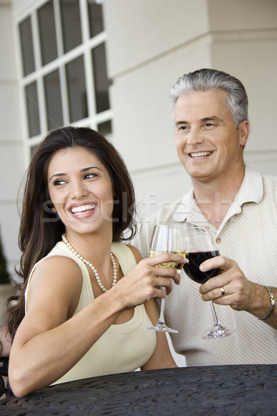 Couple toasting with wine. Stock photo © iofoto