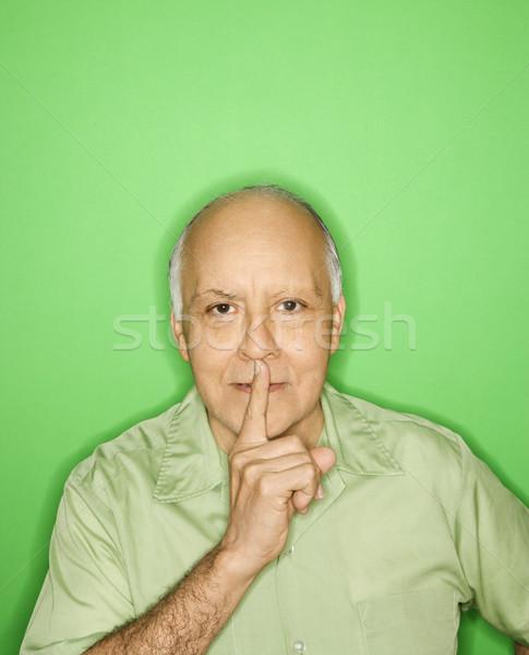 Férfi tart ujj száj kaukázusi középkorú felnőtt Stock fotó © iofoto