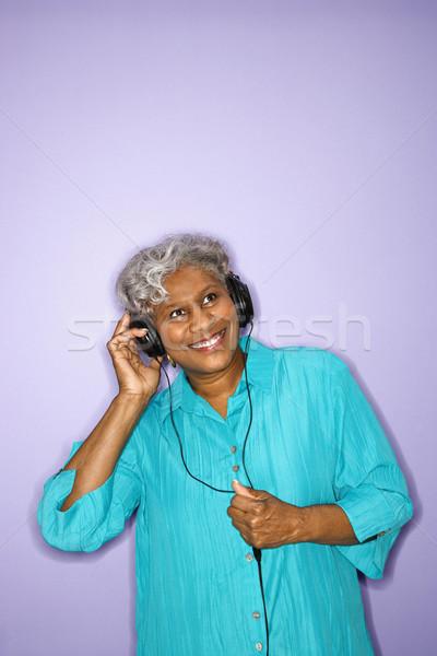 Woman listening to headphones. Stock photo © iofoto
