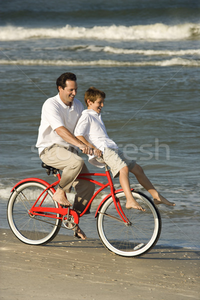 Dad riding bike with son . Stock photo © iofoto
