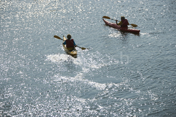 Boys in kayaks. Stock photo © iofoto