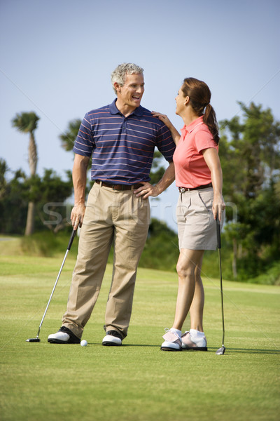 Couple talking on golf course Stock photo © iofoto