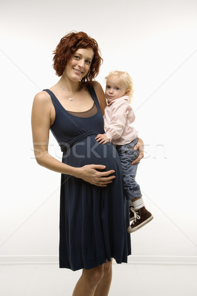 Pregnant woman holding child. Stock photo © iofoto
