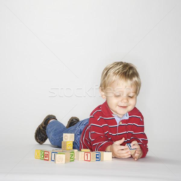 Boy playing with blocks. Stock photo © iofoto