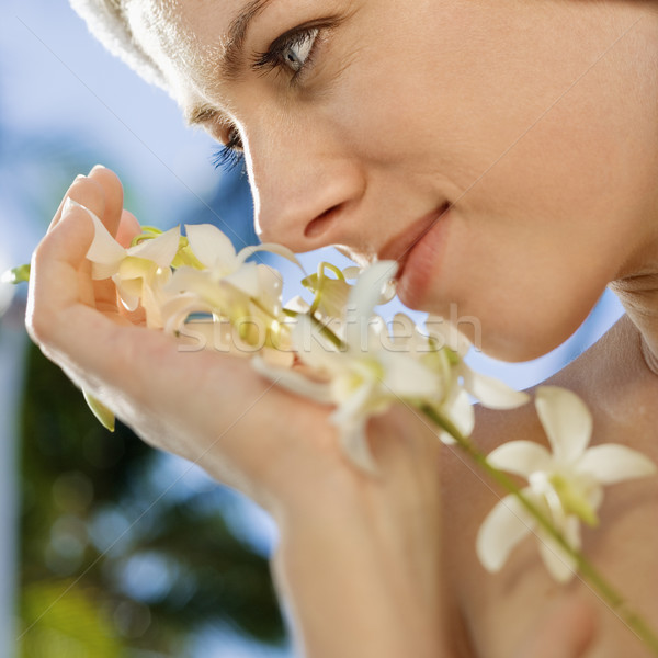 Woman with flowers. Stock photo © iofoto