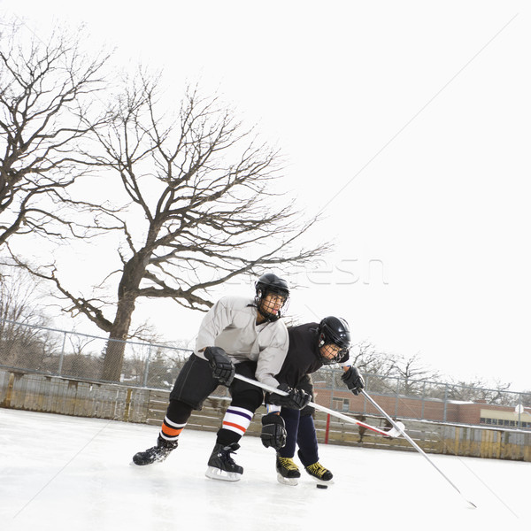 Fiúk játszik téli sport kettő jégkorong egyenruhák Stock fotó © iofoto