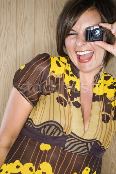 Kobieta miniatura kamery dorosły brunetka Zdjęcia stock © iofoto