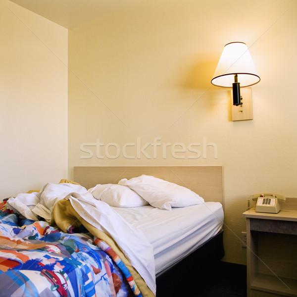 кровать мотель интерьер выстрел комнату стены Сток-фото © iofoto