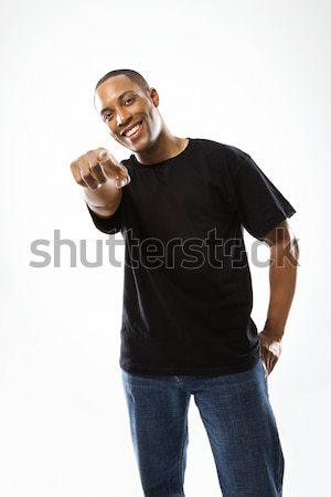Hombre senalando sonriendo jóvenes masculina retrato Foto stock © iofoto