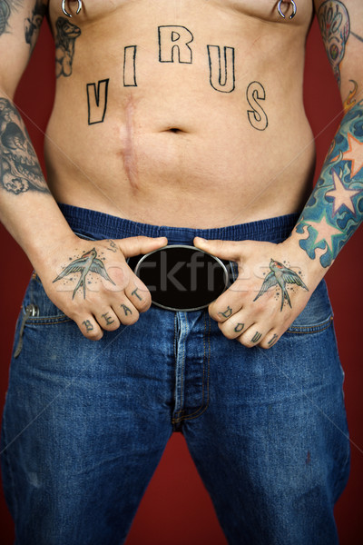 Adult male with tattoos. Stock photo © iofoto