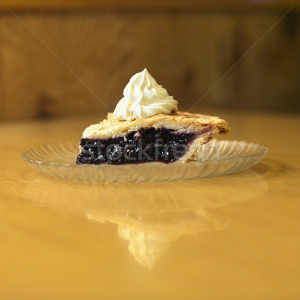 Stock photo: Slice of blueberry pie on plate with whipped topping.