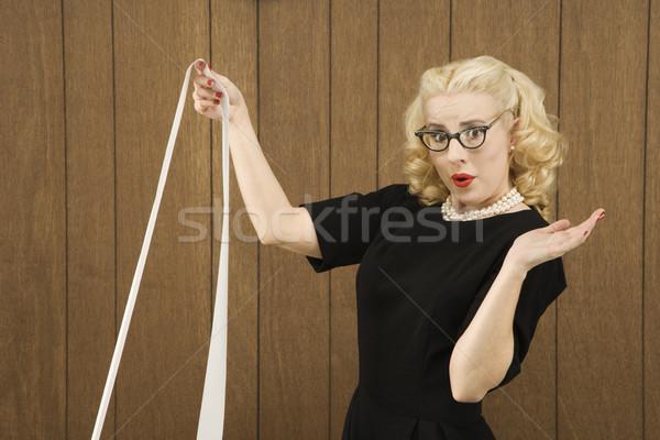 Woman holding printout. Stock photo © iofoto