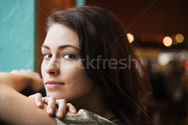 Portre genç kadın silah pencere eşiği Stok fotoğraf © iofoto