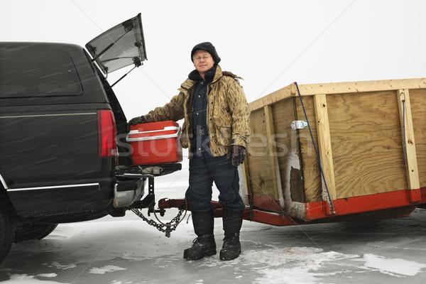 Adam buz balık tutma kafkas kamyon dondurulmuş Stok fotoğraf © iofoto