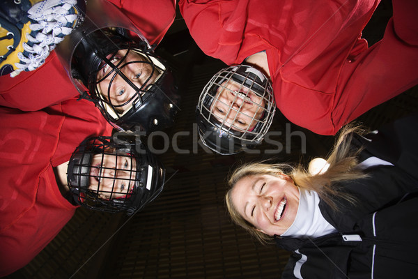 Women hockey player huddle. Stock photo © iofoto