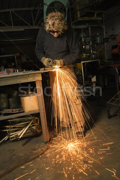 Metalsmith creating sparks. Stock photo © iofoto