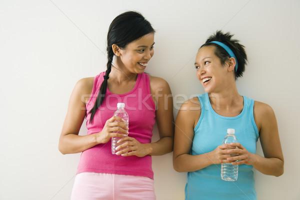 Fiatal nők barátok kettő áll edzés ruházat Stock fotó © iofoto