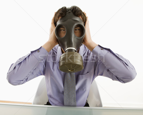 Man wearing gas mask with hands over ears. Stock photo © iofoto