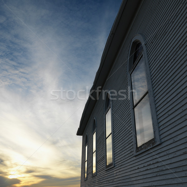 Wooden building at sunset. Stock photo © iofoto