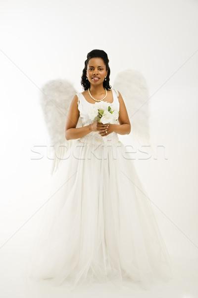 Angyali menyasszony tart virágcsokor fehér nő Stock fotó © iofoto