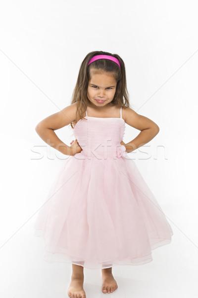 Little girl wearing pink dress pouting. Stock photo © iofoto