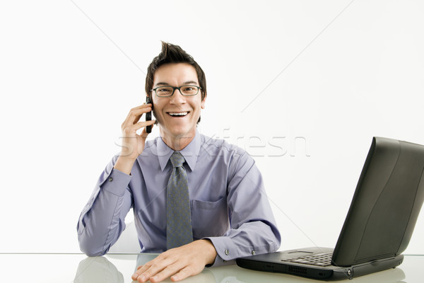 Smiling businessman on cell phone. Stock photo © iofoto