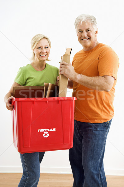 Stock photo: Couple with recycling bin.