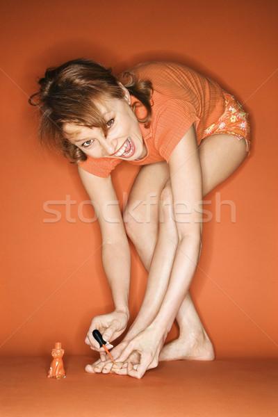 Woman applying toenail polish. Stock photo © iofoto