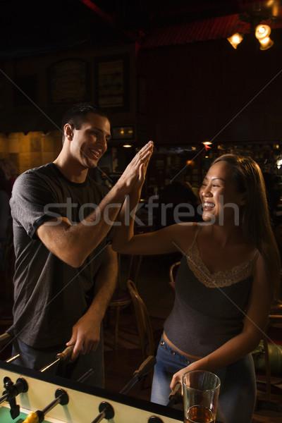 Couple giving high five. Stock photo © iofoto