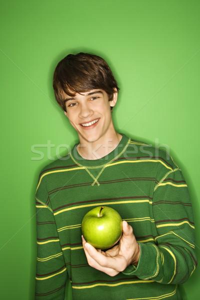 Boy holding apple. Stock photo © iofoto