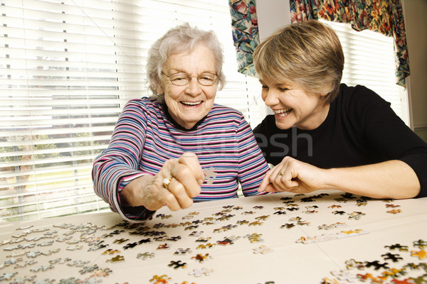 Elderly Woman and Younger Woman Doing Puzzle Stock photo © iofoto