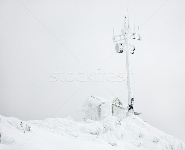 Cabin and antenna in snow. Stock photo © iofoto
