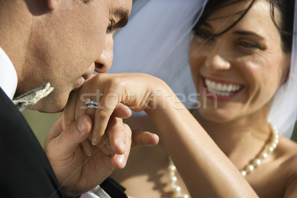 Groom kissing hand of bride. Stock photo © iofoto
