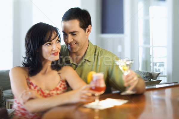 Pareja bar sonriendo potable hombre mujer Foto stock © iofoto