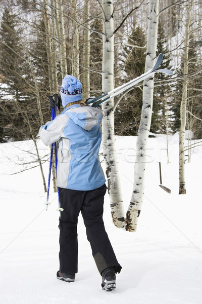 Female walking with skis. Stock photo © iofoto
