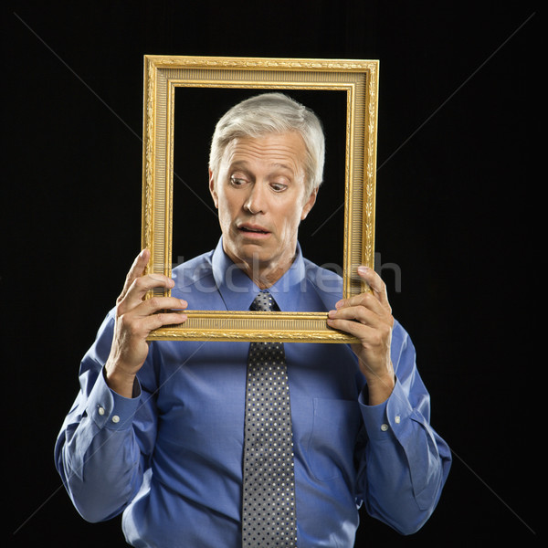 Man holding picture frame. Stock photo © iofoto