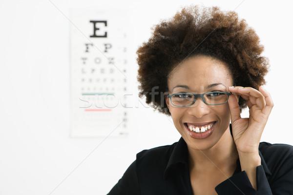 Nő szemorvos portré afro visel szemüveg Stock fotó © iofoto