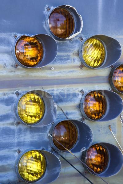Old taillights on blue siding. Stock photo © iofoto
