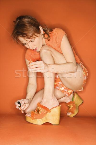 женщину Живопись кавказский оранжевый лак для ногтей цвета Сток-фото © iofoto