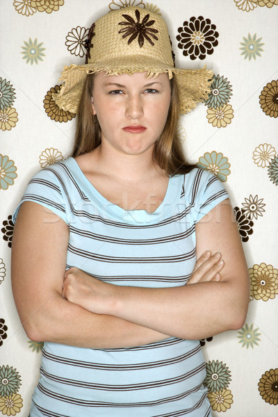 Woman pouting with arms crossed. Stock photo © iofoto