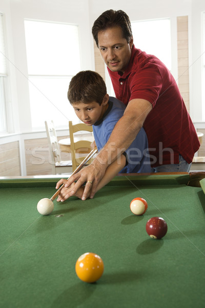 Father and Son Playing Pool Stock photo © iofoto