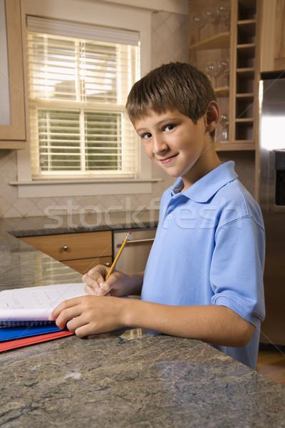 мальчика домашнее задание кавказский кухонном столе глядя дома Сток-фото © iofoto