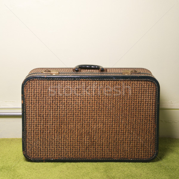 Suitcase on floor. Stock photo © iofoto